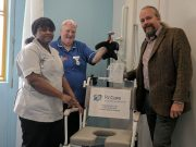 P J Care, donate a shower chair to the Stroke Unit at MK Hospital