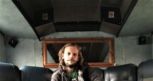 Thomas Davis from The Bus Shelter MK inside his bus