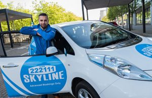 Skyline Taxis owner Gavin Sokhi with a Nissan Leaf Taxi